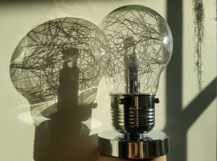 Close-up Of Light Bulb Against The Wall