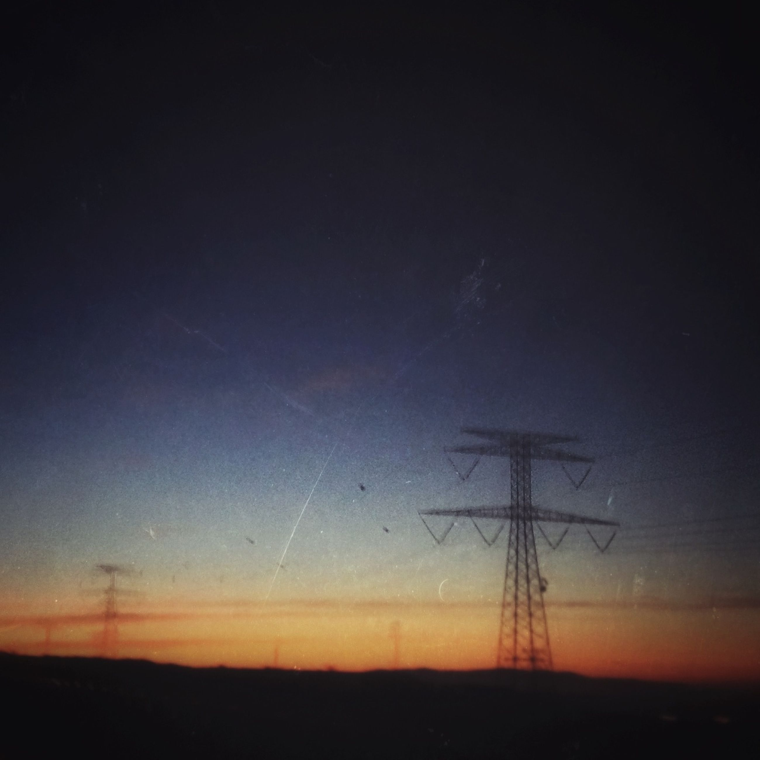 silhouette, fuel and power generation, electricity pylon, landscape, electricity, tranquility, technology, tranquil scene, power line, power supply, sunset, sky, scenics, field, nature, beauty in nature, dusk, wind turbine, wind power, alternative energy