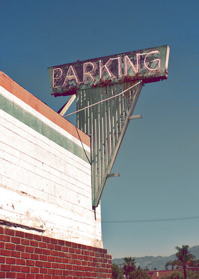 Abandoned Buildings Architecture Blue Skies Bowling Alley Building Exterior Built Structure Clear Sky Day Low Angle View Neon Sign No People Outdoors Parking Sign Sky Sport