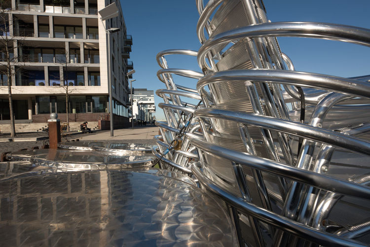 Cologne, GERMANY - February 15, 2019: The Rheinau-Harbor impresses with great modern architecture during an unnaturally warm winter day Metal Water Day Nature Sky No People Architecture Outdoors Built Structure Reflection Building Exterior Close-up Sunlight Steel Stainless Steel  In A Row Building Silver Colored Industry