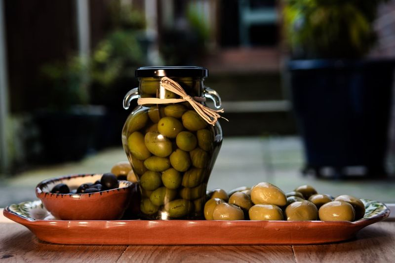 Close-up of olives on table