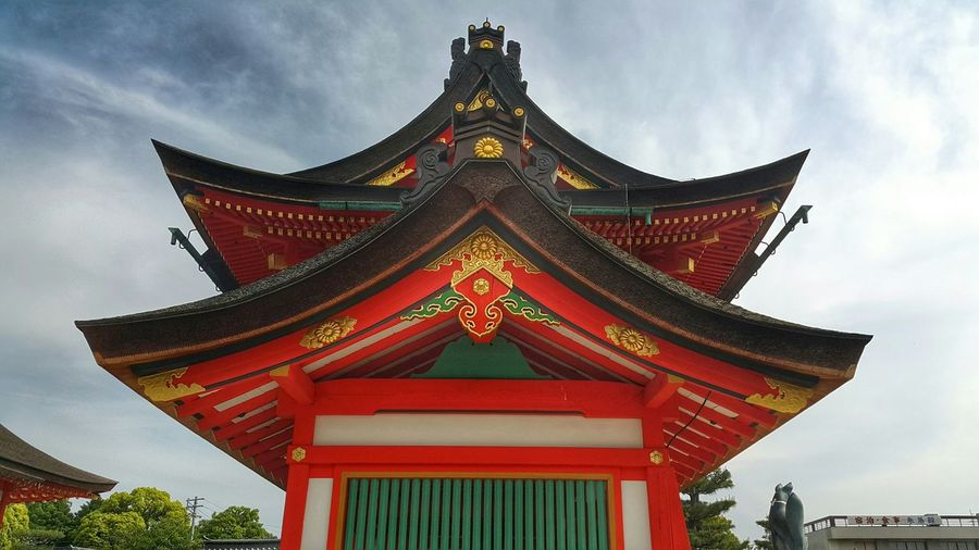 Low Angle View Of Fushimi Inari Shrine Against Sky