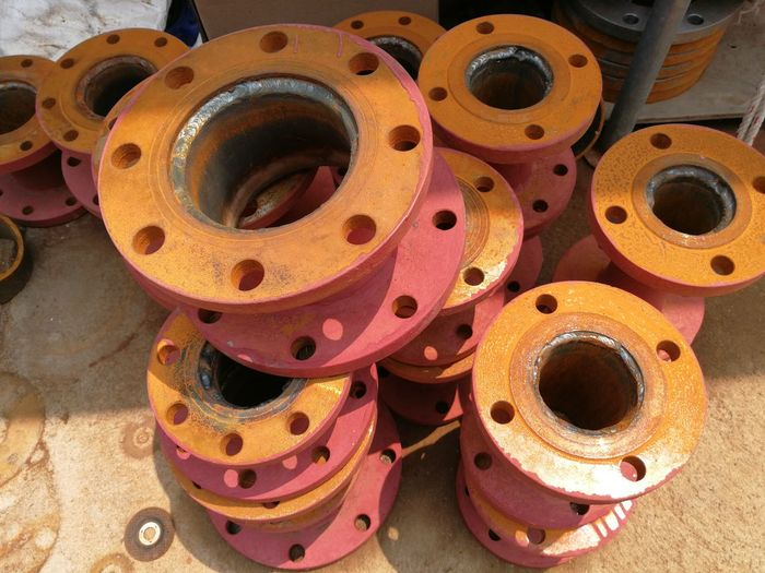 Flanges Welded Steel Workshop Industrial Stack Spool Rolled Up High Angle View Close-up Circle Hole Circular Sheet Metal