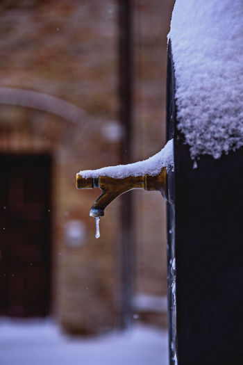 Close-Up Of Frozen Faucet During Snow