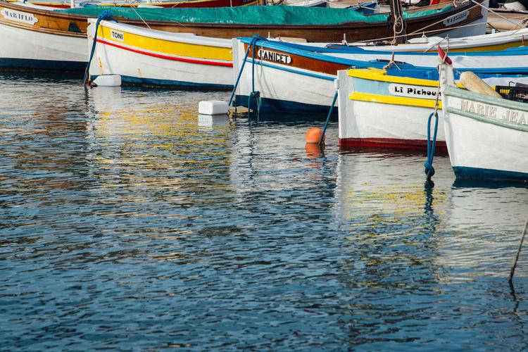Fishing boat moored at harbor