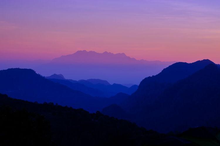 Scenics - Nature Beauty In Nature Mountain Sky Tranquil Scene Tranquility Sunset Mountain Range No People Idyllic Environment Silhouette Nature Non-urban Scene Landscape Orange Color Majestic Outdoors Dusk Mountain Peak