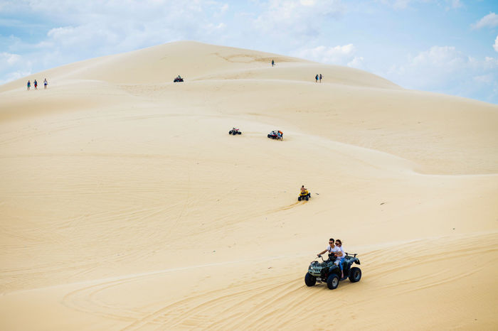 White Sand Dunes, Mui Ne, located in the south of Vietnam. It's about 5-hour away from Ho Chi Minh City. Adventure Arid Climate Beauty In Nature Cloud - Sky Desert Landscape Leisure Activity Lifestyles Mui Ne Muine Muine, Vietnam  Nature Off-road Vehicle Outdoors Riding Sand Sand Dune Sky Transportation Travel Destinations Unrecognizable Person White Sand Dunes Break The Mold The Great Outdoors - 2017 EyeEm Awards Neighborhood Map Live For The Story Let's Go. Together. Lost In The Landscape Lost In The Landscape Connected By Travel An Eye For Travel Go Higher