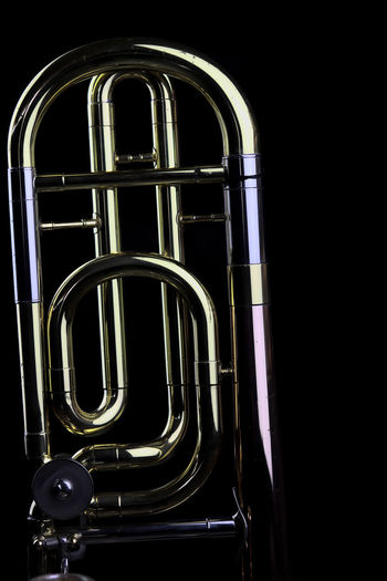 Music Instrument Trombone Metal No People Indoors  Black Background Studio Shot Night Arts Culture And Entertainment Close-up Dark Brass Instrument  Illuminated Musical Instrument Window Low Angle View Architecture Shiny Steel Brass Alloy