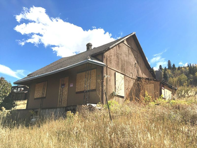 Old Miner's house Architecture Built Structure Grass Building Exterior House Sky Blue Abandoned Residential Structure Rural Scene Grassy Day Obsolete Cloud Outdoors Cloud - Sky Growth Mining Heritage Mining Town Mining History Of America