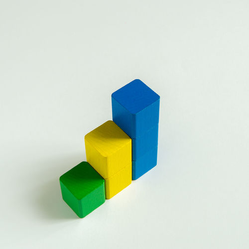wood blocks statistic Blue Color Green Color Growth Wood Blocks Backgrounds Bar Bar Graph Close-up Day High Angle View Multi Colored No People Statistics  Studio Shot White Background Yellow Color
