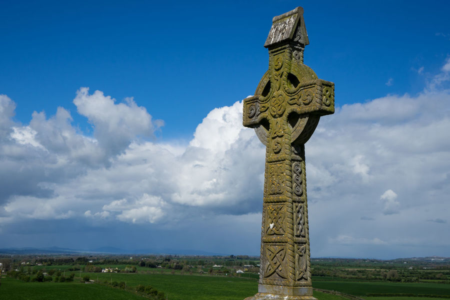 Architecture Cemetery Church Cloud - Sky Crux Day Field Grass Green Color History Human Representation Ireland Irish Low Angle View Nature No People Outdoors Place Of Worship Religion Rock Of Cashel Sculpture Sky Spirituality Statue Travel Destinations