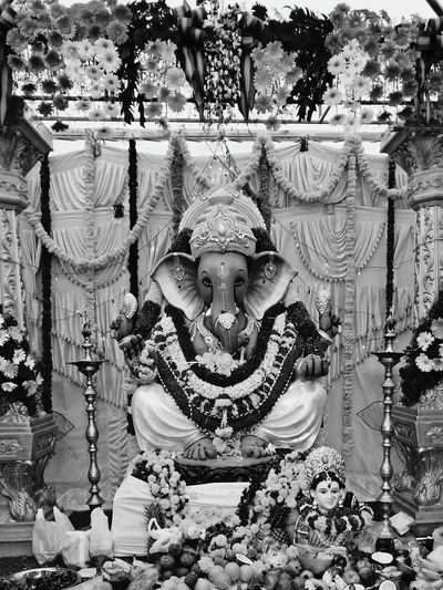 Religion Art And Craft Spirituality Human Representation Statue Place Of Worship Temple - Building Creativity Golden Culture Culture Flower Day Religious Offering Ganpati Ganesh Ganesh Chturthi GaneshChaturthi Ganeshfestival Ganesh Mahotsava Ganesha Portrait