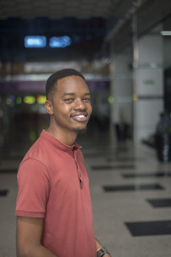 Black Model Young Adult Smiling Happiness Happy Teeth Model One Person Real People Focus On Foreground Standing Casual Clothing Portrait Lifestyles Young Men Emotion Indoors  Front View Leisure Activity Waist Up Architecture Looking At Camera