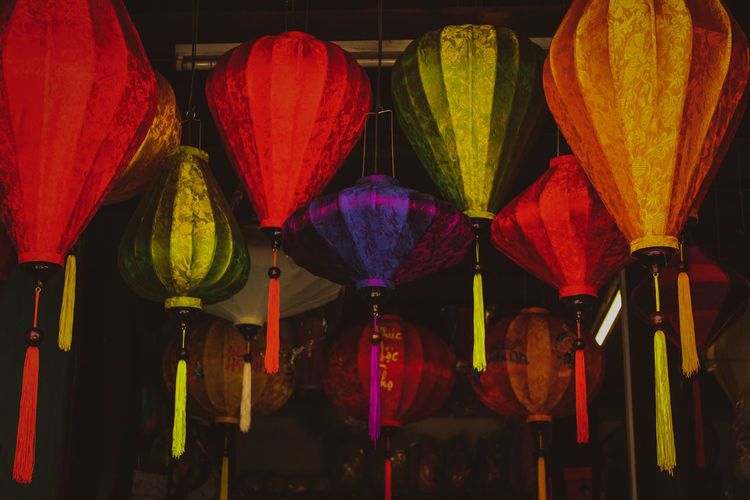Colorful lanterns hanging for sale at market stall