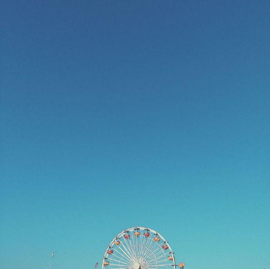 Ferris Wheel At Santa Monica Against Clear Blue Sky On Sunny Day