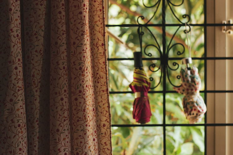 Prep for the rains Copy Space Umbrella Rains Monsoon Rainyweather Plants Trees Indoor Calm Sunday Bedroom Aesthetic Curtain Window Pattern Close-up Drapes  Metal Grate Wrought Iron Window Sill Wind Chime EyeEmNewHere