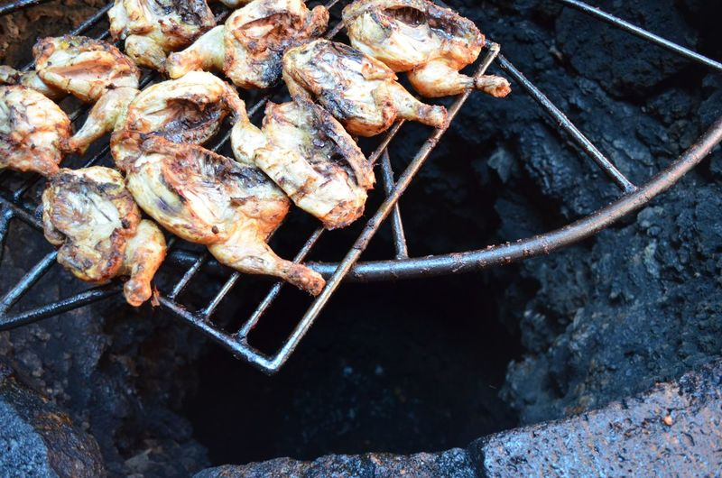High angle view of roasted chicken on barbecue