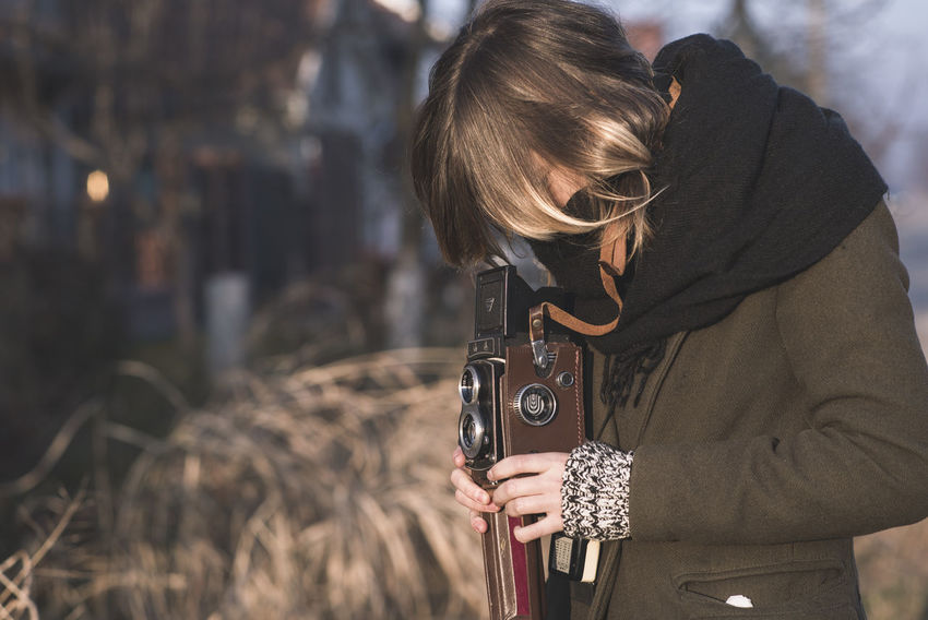 Analogue Photography Adult Close-up Day Focus On Foreground Leisure Activity Lifestyles One Person Outdoors People Real People Rear View Warm Clothing Weapon Women Young Adult