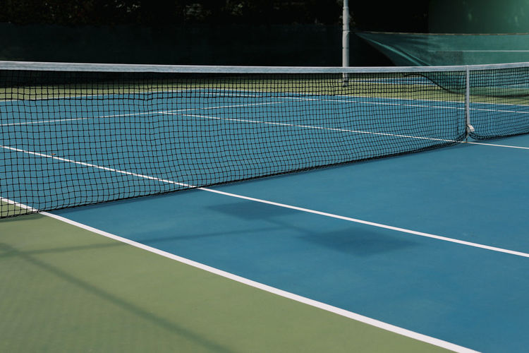 Absence Competition Competitive Sport Court Day Dividing Line Empty Green Color High Angle View Leisure Activity Leisure Games Net - Sports Equipment No People Outdoors Racket Sport Recreational Pursuit Sport Sports Equipment Table Tennis Tennis Tennis Net Yard Line - Sport