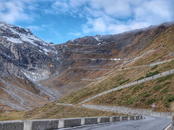 Stelvio Pass in the morning Mountain Mountain Range Landscape Scenics Nature Beauty In Nature Sky Outdoors Day No People Cloud - Sky Tranquility Road Snow Scenery Motorcycle Motorbike