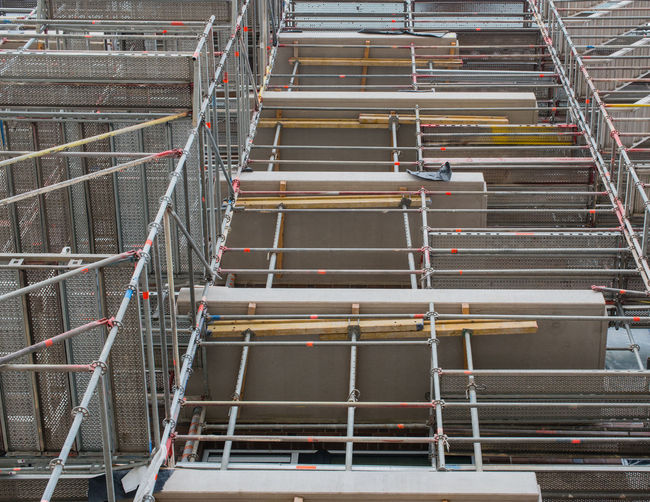 Scaffolding attached to a building Auxiliary Construction Catching Scaffold Construction Site Façade Formwork Scaffolding Scaffolding Structural Parts Suspended Scaffolding System Scaffolding Work Platform Work Scaffolding Working Material Fastening Plastering