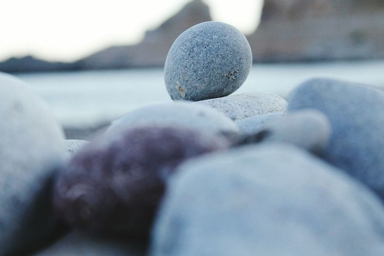 Stone - Object Beach Selective Focus Surface Level Shore Focus On Foreground Day Stone Nature Grey Tranquility Vacations Greece Memories Sea
