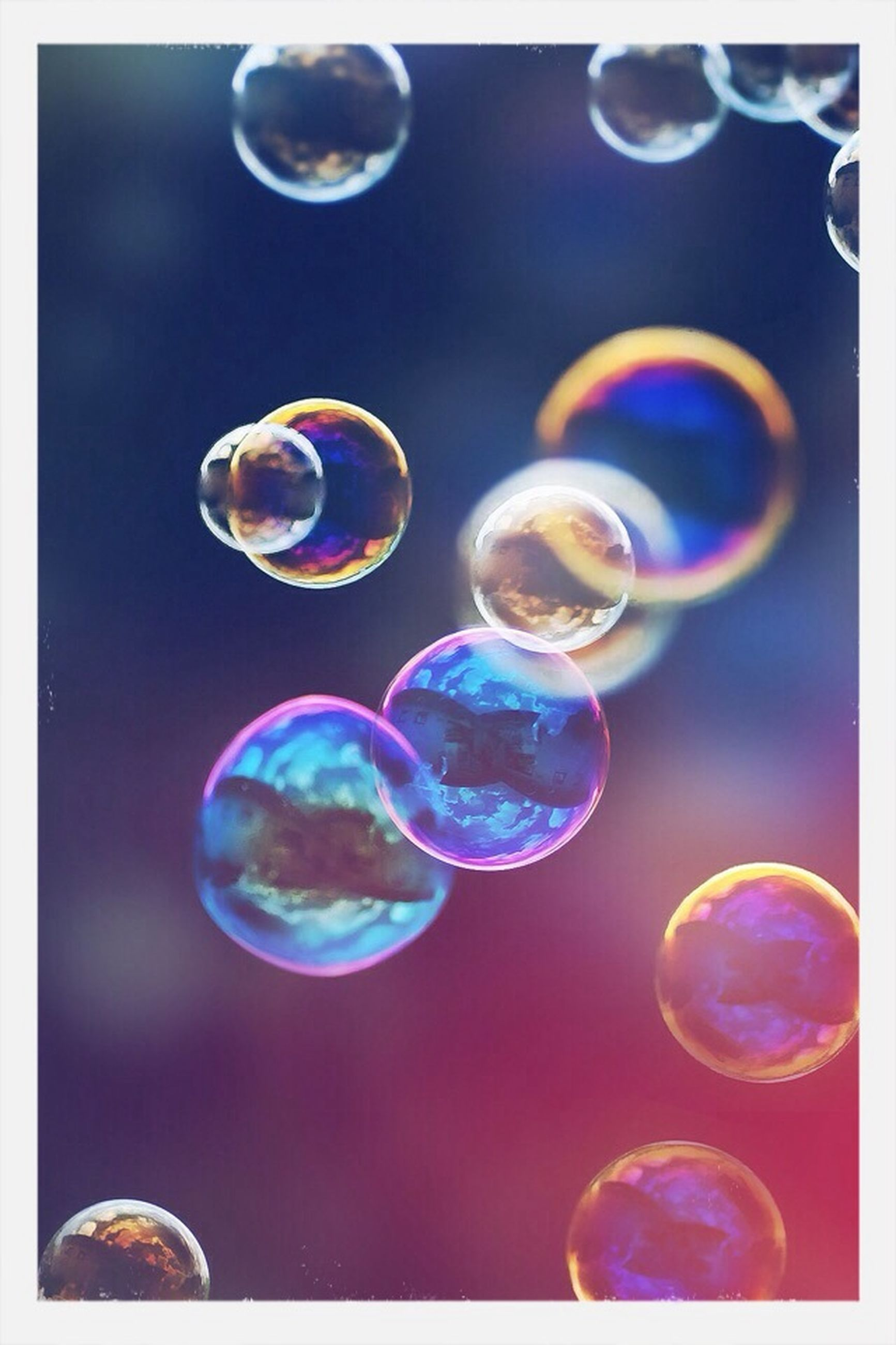 bubble, transparent, water, fragility, close-up, blue, mid-air, drop, sphere, jellyfish, beauty in nature, glass - material, nature, multi colored, circle, no people, focus on foreground, underwater, full frame, soap sud