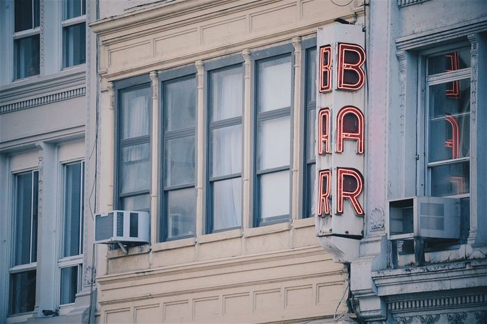 Side of a building with a Bar awning. Building Exterior Architecture Built Structure Window Outdoors No People Day City Signage Bar Sign Urban Geometry