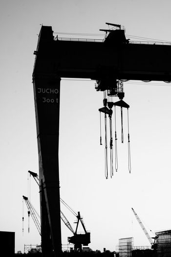 Low Angle View Sky Architecture No People Built Structure Machinery Day Clear Sky Crane - Construction Machinery Industry Metal Building Exterior Outdoors Silhouette Technology Construction Site Construction Equipment Industrial Equipment