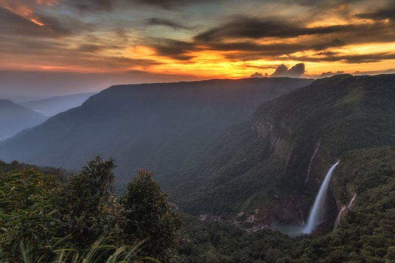 Last light at Nohkalikai Tree Mountain Sunset Fog Forest Sunlight Sun Summer Gold Colored High Angle View Waterfall Flowing Water Stream - Flowing Water Long Exposure Power In Nature Flowing Falling Water Mountain Peak Panoramic Dawn Fall Pine Woodland Pinaceae Rapid Surf Stream Valley