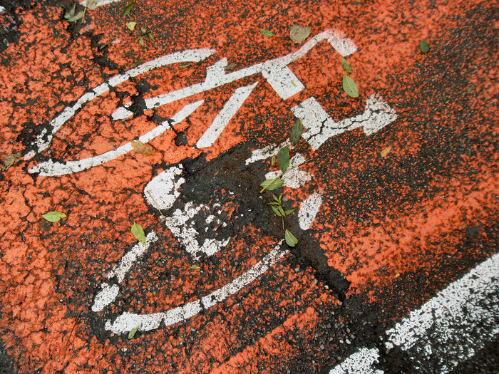 Art Art And Craft Asphalt Bycicle Lane Close-up Communication Day EyeEm Gallery High Angle View No People Orange Color Outdoors Streetphotography The City Light
