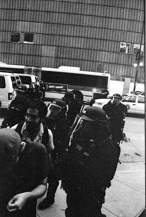 Protests at the 2008 Democratic National Convention (DNC) 2008 Democratic National Convention Black & White Film Protest Adult Adults Only Architecture Black And White Black And White Photography Blackandwhite Blackandwhite Photography Building Exterior Built Structure Civil Disturbance Day Film Photography Indoors  Lifestyles Men One Person People Protesters Real People Standing Transportation Tri-x 400 Pushed Women