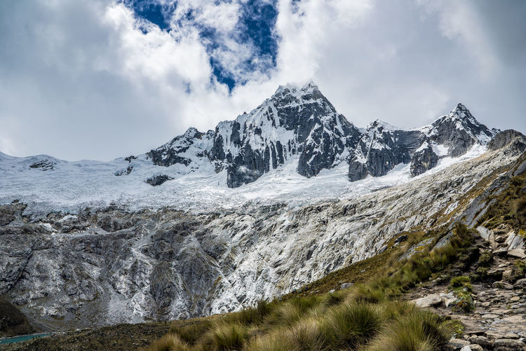 EyeEmNewHere Hiking Huaraz Peru Beauty In Nature Cloud - Sky Cold Temperature Day Environment Land Landscape Mountain Mountain Peak Nature No People Outdoors Peak Punta Union Rock Rock - Object Santa Cruz Scenics - Nature Sky Snow Snowcapped Mountain