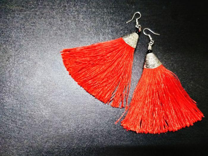 Close-up of red umbrella hanging over black background