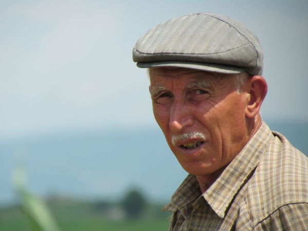 Adult Close-up Day Flat Cap Headshot Nature One Man Only One Person One Senior Man Only Only Men Outdoors People Portrait Real People Sea Senior Adult Senior Men Sky Water