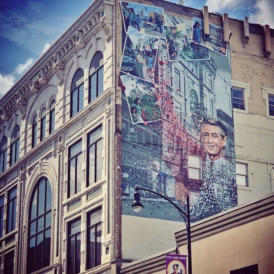 Woman on building in city