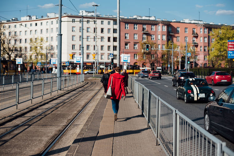 Warsaw in Spring The Week on EyeEm Light And Shadow Spring Street Photography Capture The Moment Nikon D750 Traveling City Life Architecture Building Exterior Built Structure City Transportation Rear View One Person Full Length Mode Of Transportation Street Day Sunlight Real People Motor Vehicle Car Walking Building Nature Outdoors Track
