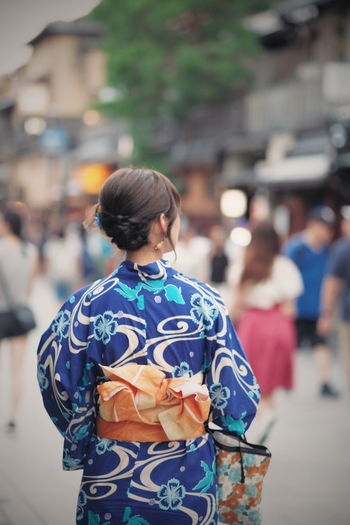 Rear View Of Woman Walking Outdoors