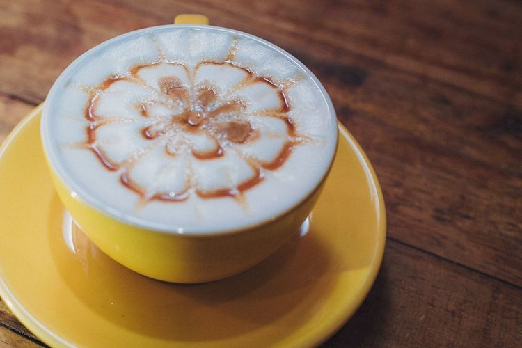 a cup of Caramel Macchiato Coffee Cup Coffee - Drink Frothy Drink Drink Table Food And Drink Cappuccino Froth Art Refreshment Close-up No People Indoors  Day Caramel Macchiato Caramel Drinks Relax Relaxing Chilling Freshness Serving Size Cafe Cup Enjoying Life Food Photography