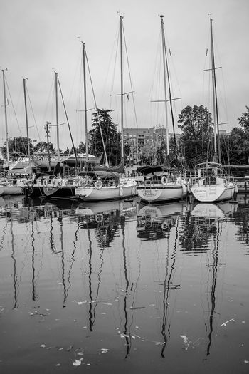 down by the harbour Water Nautical Vessel Lake Mast Reflection Tall Ship Sailboat Sky Landscape Cloud - Sky Marina Yacht Reflection Lake Moored Boat Dock Recreational Boat