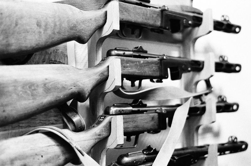 Close-Up Of Rifles On Rack