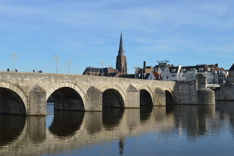 Arch Arch Bridge Arched Architecture Bridge Building Exterior Built Structure Church Connection Culture Engineering Famous Place Geometry Historic History Horizontal Symmetry International Landmark Maastricht Netherlands Old Outdoors Stone Wall Symmetry The Way Forward Tree