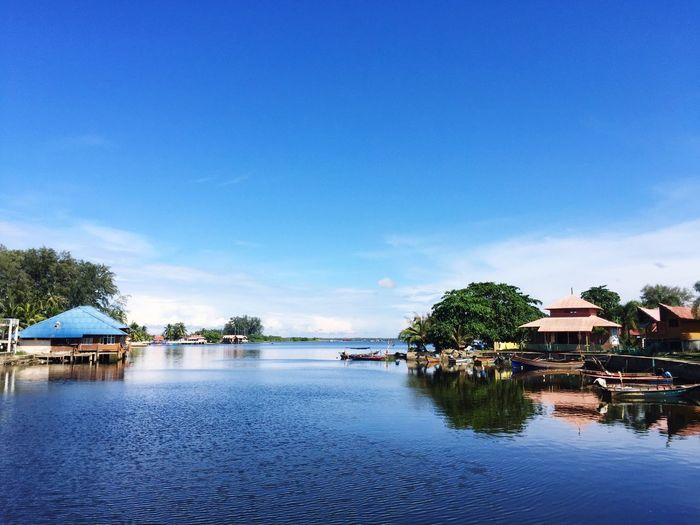 Sri Tujuh Beach, Tumpat Kelantan Water Blue Tree Built Structure Nature Tranquil Scene Sky Tranquility Beauty In Nature Reflection Scenics Building Exterior Architecture Waterfront Outdoors Stilt House Idyllic No People Day Nautical Vessel