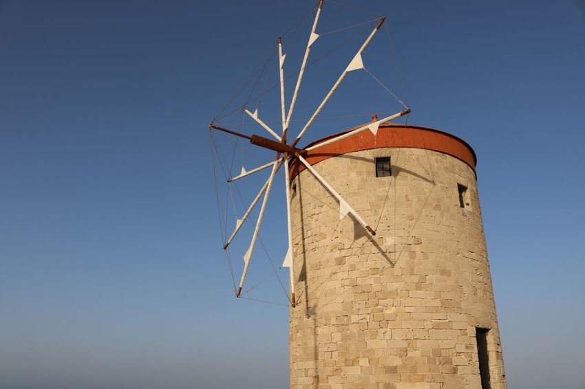 Ródos Alternative Energy Architecture Blue Day Environmental Conservation Fuel And Power Generation Greece Industrial Windmill Low Angle View No People Outdoors Renewable Energy Rural Scene Sky Technology Traditional Windmill Wind Power Wind Turbine Windmill