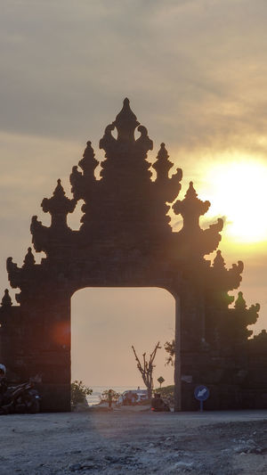 Balinese Gate Temple Badung Silhouette Bali Melasti Beach INDONESIA Sunset Beach Temple Flare Stone Rock Sky Landscape_Collection Landscape_photography Sky And Clouds Rock - Object Building Door Gate