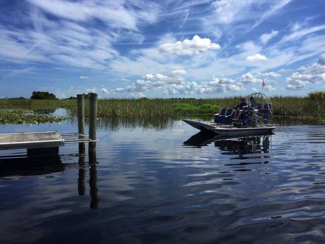 Airboat docking Airboat Florida Nature Three Forks WMA Clouds And Sky