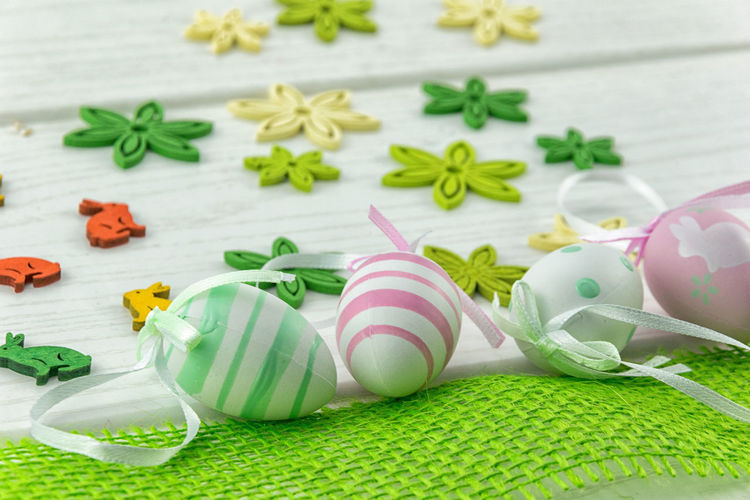 Close-Up Of Easter Eggs With Decorations On Table