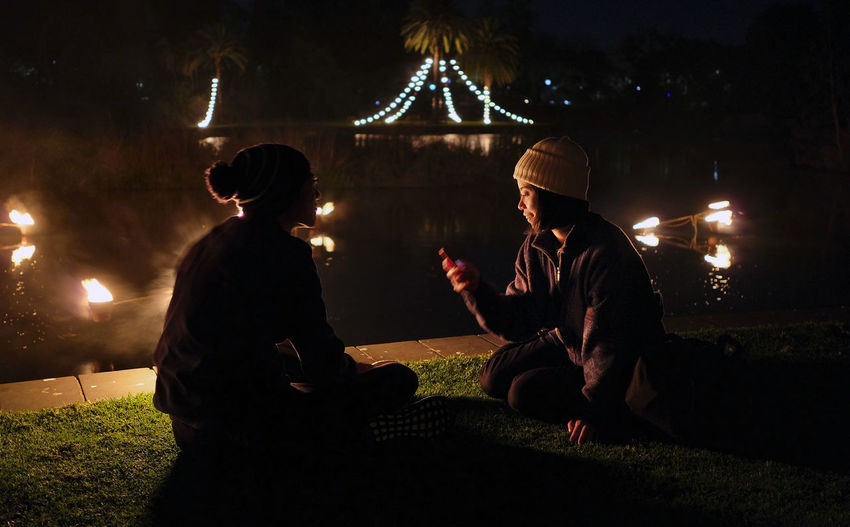 Couple Casual Clothing Couple - Relationship Grass Illuminated Lake Night Selfie Sitting Two People