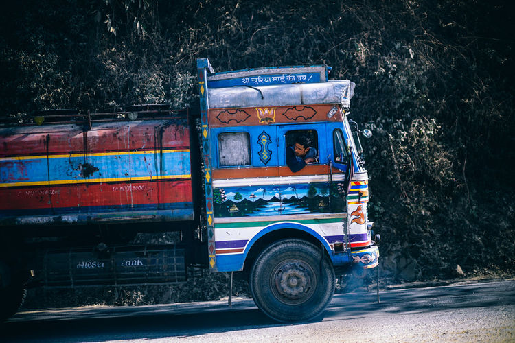 Truck Driver Going Up A Hill. Driver Driving Green Heavy Hills Road Blue Diesel Drive Engine Forest Going Greenery Heavy Vehicle Hill Hill Top Hilly Mountains Outdoors Outside Truck Up Vehicle Wheels Window