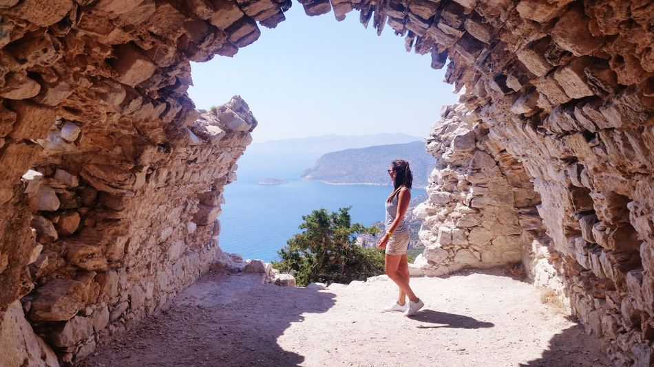 Castle of Monolithos pt.2 Sea Panorama Landscape Horizon Over Water Beautiful Sky Cielo Rhodes Greece Monolithos Castle View Full Length Young Women Women Discovery Rock - Object Natural Arch Mountain City Rock Formation Adventure Cave Coast Wave Tranquil Scene Scenics Idyllic Eroded Natural Landmark